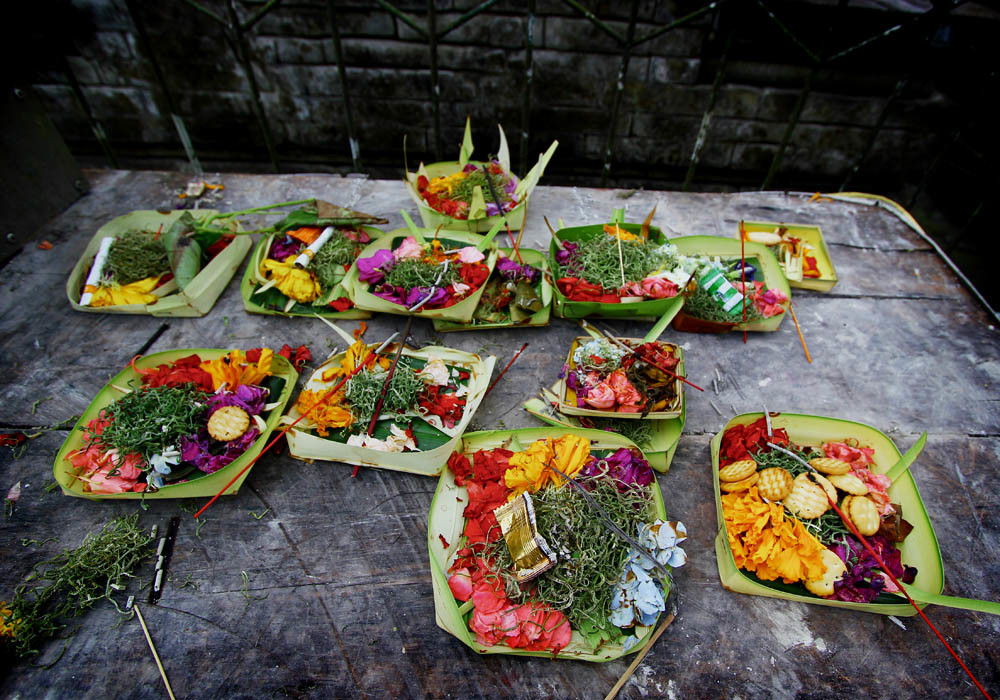 Balinese canang offerings left by Hindu devotees at Tirta Empul Temple, Tampaksiring, Bali, Indonesia